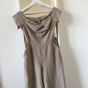 Nude off-shoulder jumpsuit with front pockets